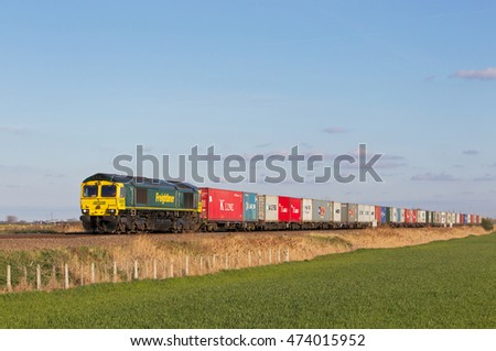 ELY, UK - APRIL 22: An intermodal Freightliner service on route to Crewe from Felixstowe docks passes along the fens on April 22, 2015 in Ely.