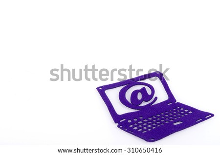 Email and laptop symbol made from carpet fabric over white background - stock photo