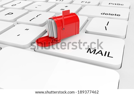 Email concept. Extreme closeup red mail box on a keyboard