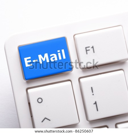 email e-mail or internet communication concept with key on keyboard - stock photo