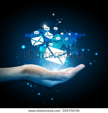 Email icon on hand - stock photo