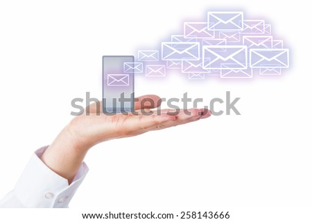 Email icons leaving a cell phone for the cloud like seeds of a blow ball in the wind. The mobile device is resting in the palm of a male hand. Isolated on white background. Cloud computing metaphor. - stock photo