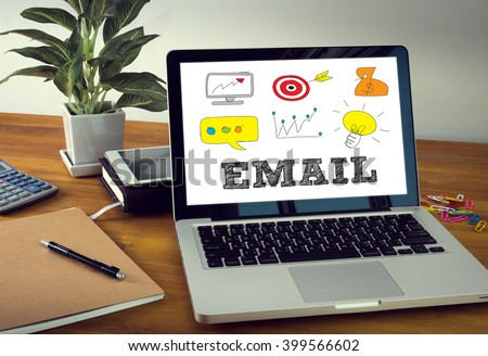 EMAIL Laptop on table. Warm tone - stock photo