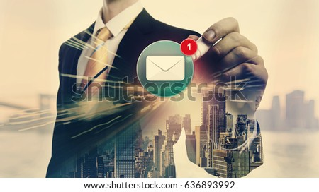 Email with double exposure of businessman and big city