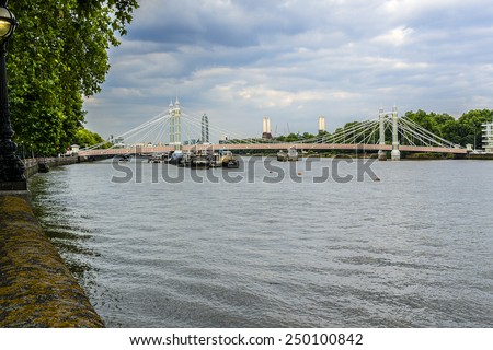 Embankment, bridges, river Thames in London in the Chelsea District. England, UK. - stock photo