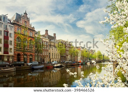 embankment  of canal ring at spring day, Amsterdam, Netherlands - stock photo