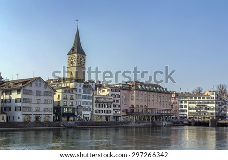 embankment of Limmat river with view of St. Peter church in Zurich, Switzerland - stock photo