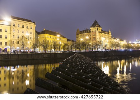 Embankment of the Vltava River near Charles Bridge, night. Prague. Czech Republic  - stock photo