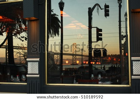 Embarcadero, San Francisco, CA, 2015 Reflection of Bay Bridge, traffic lights and palm trees in the window