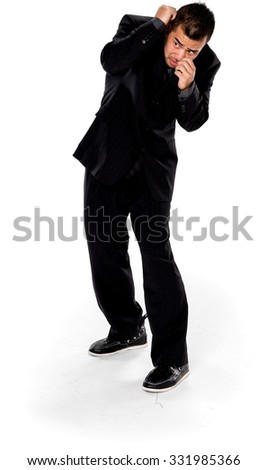 Embarrassed Asian man with short black hair in business formal outfit defending with body - Isolated