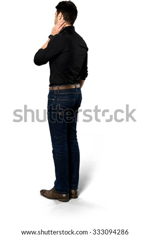 Embarrassed Caucasian man with short black hair in casual outfit with hands on neck - Isolated