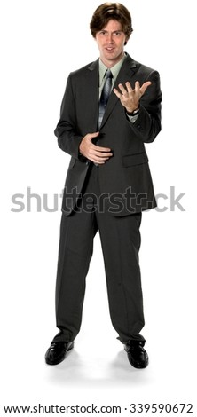 Embarrassed Caucasian man with short dark brown hair in business formal outfit with hands on stomach - Isolated