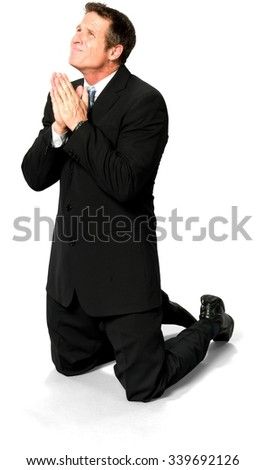 Embarrassed Caucasian man with short medium blond hair in business formal outfit begging - Isolated