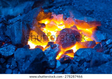 Embers and Flame of a smith's forge - stock photo