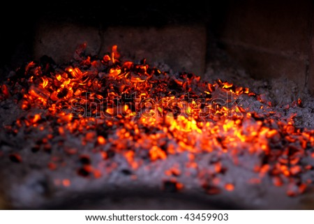 Embers in the fireplace - stock photo