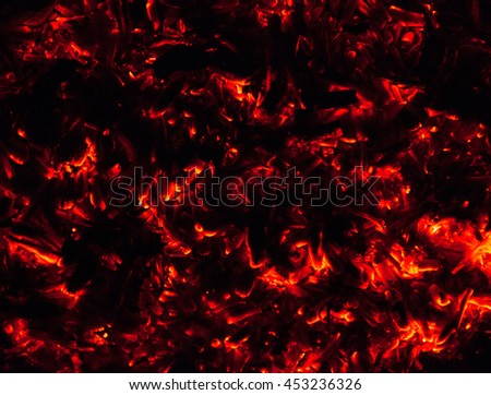 Embers of a fire glowing with heat.