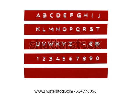 Embossed alphabet on red plastic tape - stock photo