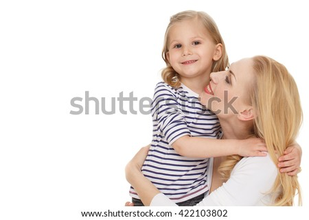 Embrace. Portrait of a loving mother hugging her little daughter at the studio on white background. - stock photo