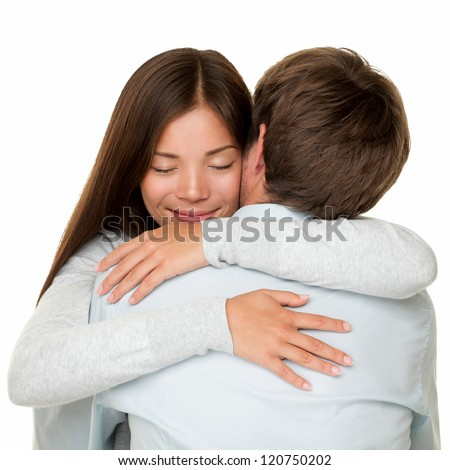 Embracing couple hugging happy. Smiling interracial couple in love isolated on white background. - stock photo