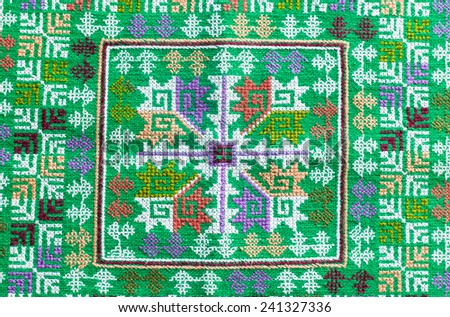 embroidered fabric texture , background - stock photo