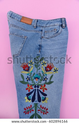 Embroidered flowers stock images royalty free images vectors embroidered flowers denim jeans pink background ccuart Images