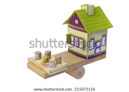 Embroidered house in balance with euro money - stock photo