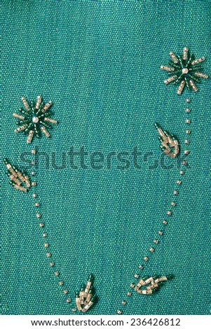 embroidered material with shells, beads, and sequins - stock photo