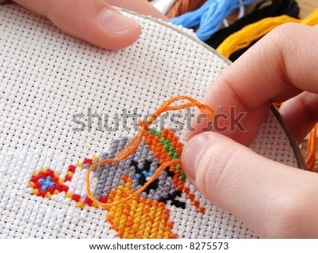 embroidery with colorful threads - stock photo