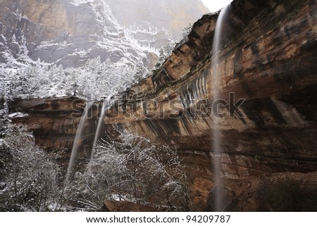 Emerald Falls in Zion Canyon during a snow storm - stock photo