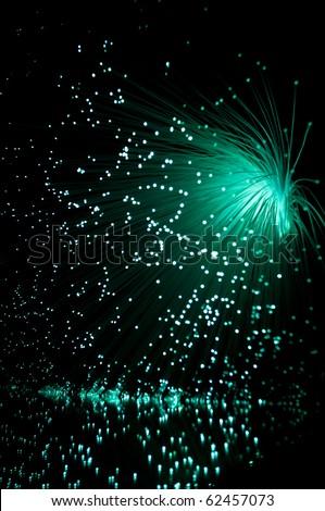 Emerald fibre optic cascade. - stock photo