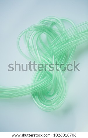 Emerald green color cable on white background. abstract.