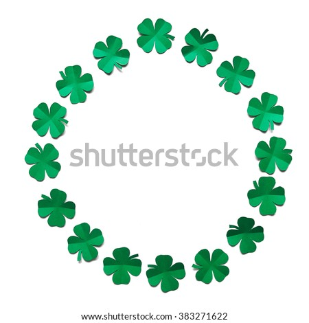Emerald green paper clover shamrock leafs wreath border frame on white background isolated. St. Patrick's Day postcard template. - stock photo