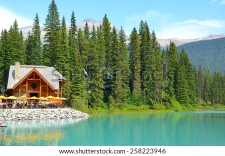EMERALD LAKE, ALBERTA - AUGUST 1 - Emerald Lake in Alberta, Canada on August 01, 2014. The beautiful Emerald Lake is visited by millions of people every year - stock photo