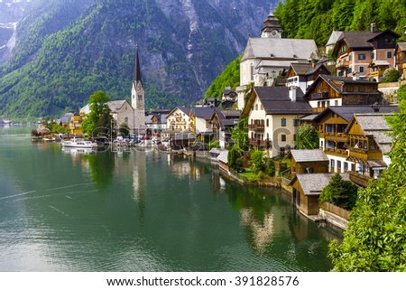 emerald lake and beautiful village Halstatt in Austrian Alps - stock photo