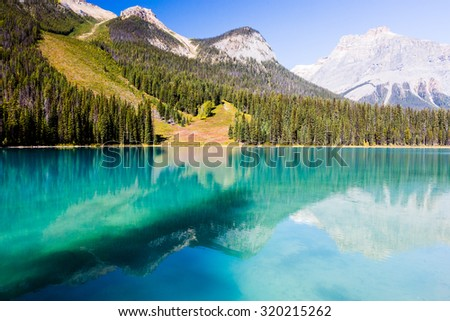 Emerald Lake is located in Yoho National Park, British Columbia, Canada. It is the largest of Yoho's 61 lakes and ponds, as well as one of the park's premier tourist attractions.