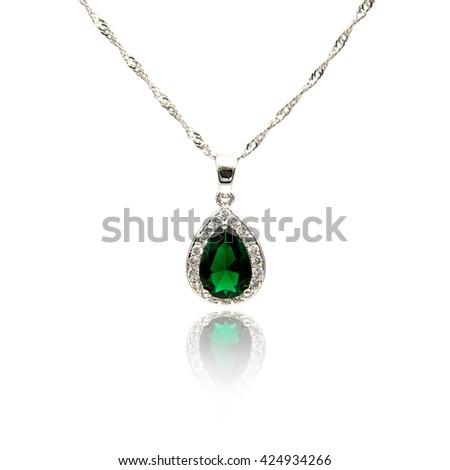 Emerald pendant isolated on white  - stock photo