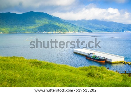 Emerald sea and beautiful port under the blue sky