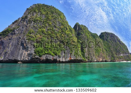 Emerald sea and fine white sand. Scenic green islands of Thailand coast