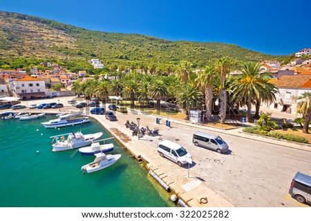 Emerald sea and palm waterfront of Vis island, Dalmatia, Croatia - stock photo