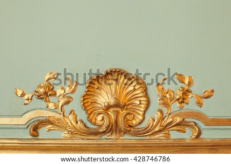 Emerald walls are decorated with gold stucco decorative elements of the Renaissance, Baroque, Potocki Palace, Lviv - stock photo