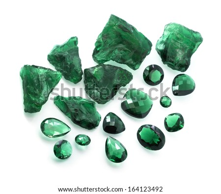Emeralds collection: many different shapes faceted and raw green gemstones. - stock photo