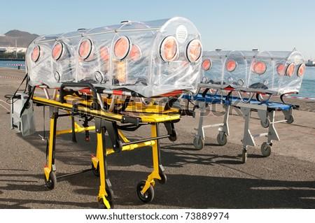 emergency ambulance bed for ebola, virus or nuclear alarm - stock photo