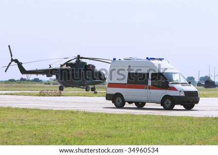 Emergency ambulance driving fast - stock photo