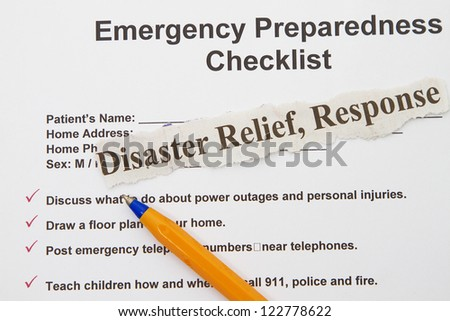 Emergency checklist preparedness abstract with pen and form.
