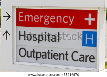 Emergency Entrance sign for a Local Hospital IV - stock photo