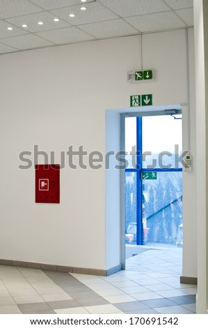 emergency exit and fire hydrant - stock photo