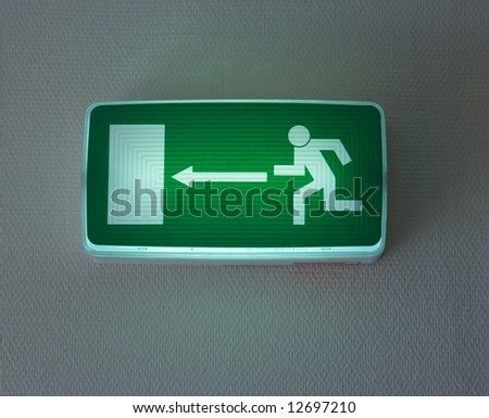 Emergency exit sign - stock photo