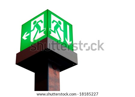 Emergency exit sign in a building glowing green light isolated on white background - stock photo