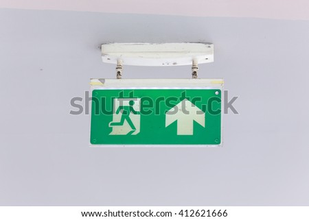Emergency exit sign isolated on white background. - Selective Focus - stock photo