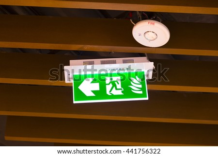 Emergency exit sign. (Selective focus) - stock photo